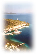 View from above Fiscardo Kefalonia, easily visted when you book our car hire